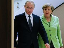 Меркель пообещала Путину поговорить с Порошенко