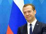 Медведев прибыл на межправительственные переговоры в Пекин